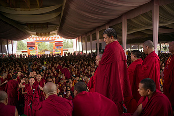 """The Teaching"". In late December 2015 His Holiness the Dalai Lama travelled to Bylakuppe, India to give a ten-day teaching to tens of thousands of people from the exile Tibetan community living in India. The events began with the inauguration of the Tashi Lhunpo monastery, one of several in the area. His daily talks, given entirely in the Tibetan language, were focused on reading and interpreting ancient Tibetan Buddhist scripture. There were some few hundred foreigners in attendance but the vast majority of the audience was comprised of monks, nuns and laypeople from neighboring exile communities."